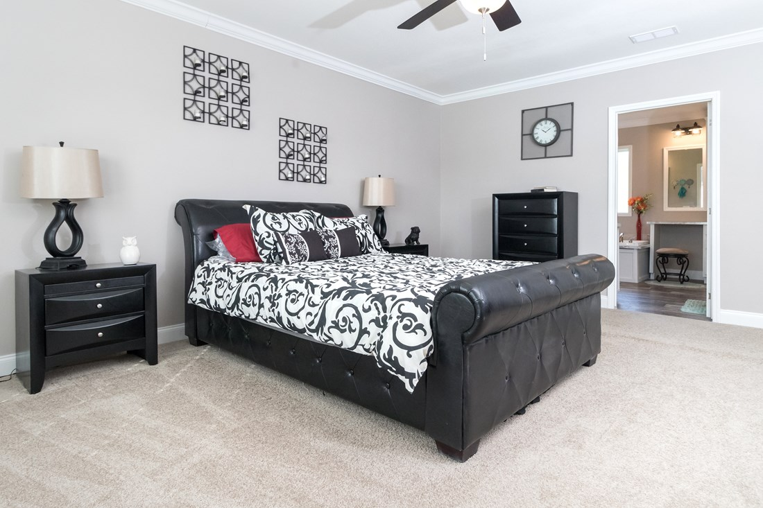 The THE TALLAHASSEE Master Bedroom. This Manufactured Mobile Home features 3 bedrooms and 2 baths.