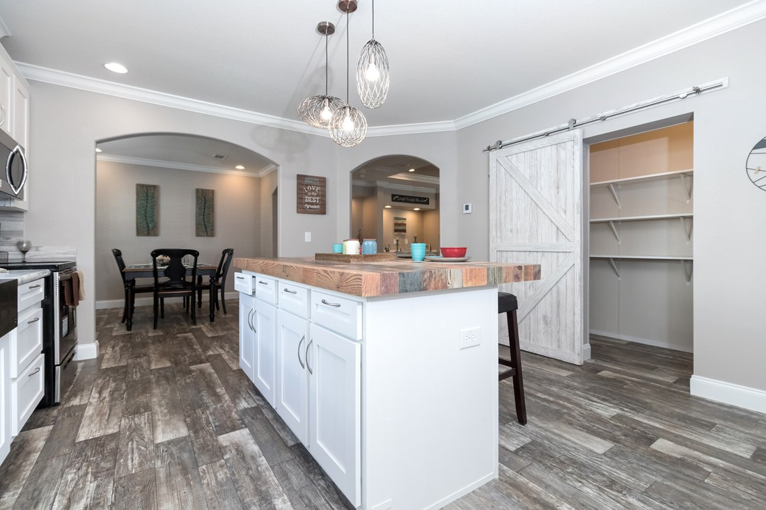 The THE TALLAHASSEE Kitchen. This Manufactured Mobile Home features 3 bedrooms and 2 baths.