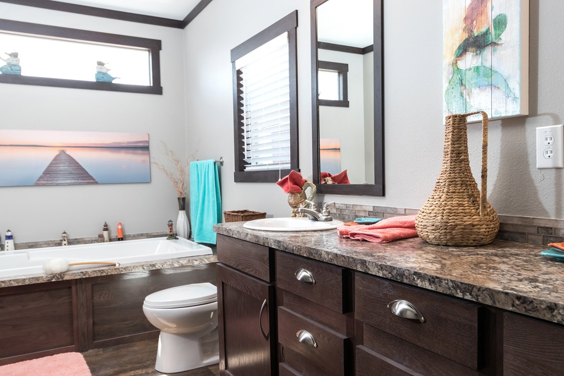 The THE PHOENIX Master Bathroom. This Manufactured Mobile Home features 4 bedrooms and 2 baths.