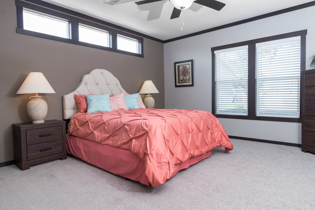 The THE PHOENIX Master Bedroom. This Manufactured Mobile Home features 4 bedrooms and 2 baths.