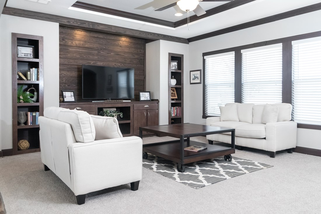 The THE PHOENIX Living Room. This Manufactured Mobile Home features 4 bedrooms and 2 baths.